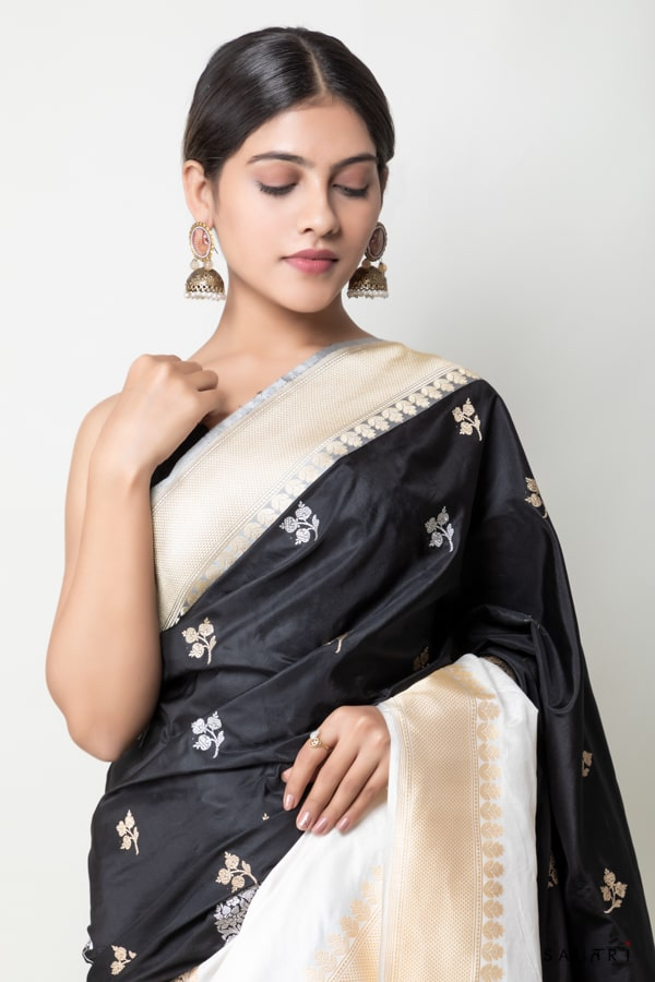 Handwoven black and white colour rankart silk saree