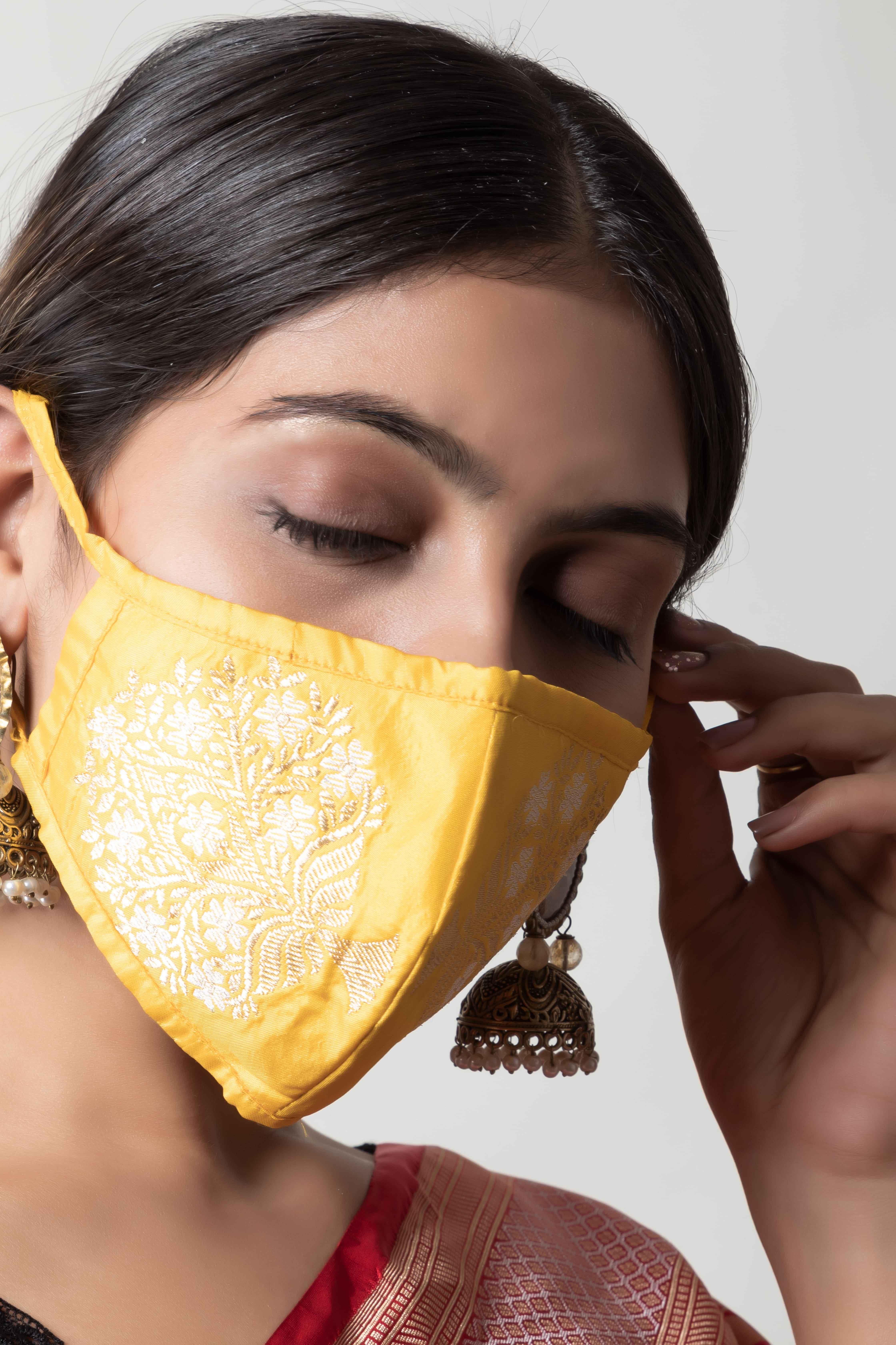 Handwoven yellow colour silk mask