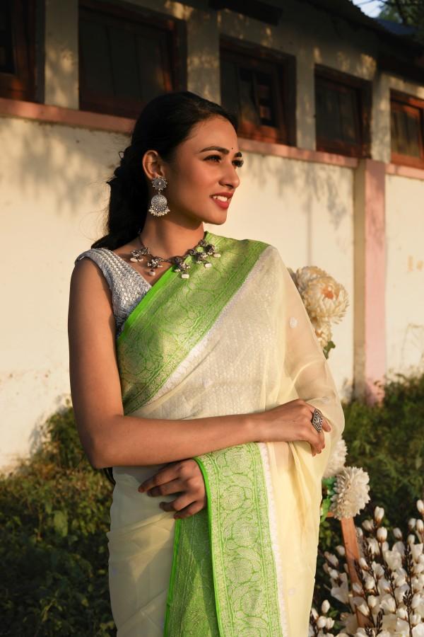 Handwoven ligth lemon colour banarasi Georgette saree with contrasting border